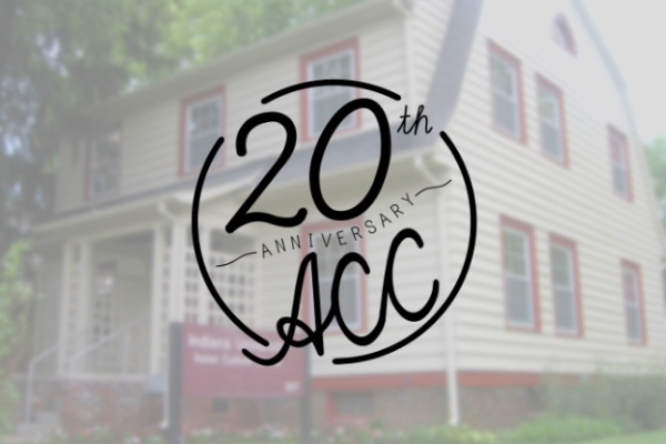 The Asian Culture Center's 20th Anniversary logo over a photo of the ACC's building